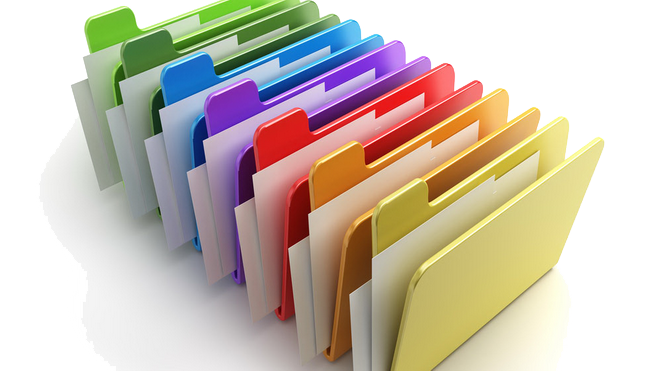 A row of folders in the colours of the rainbow, each containing a couple of white cards, conveying the pleasure of appropriate data filing for the GDPR