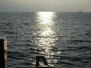 Sunset path over shimmering water_resize - Get IT Write International